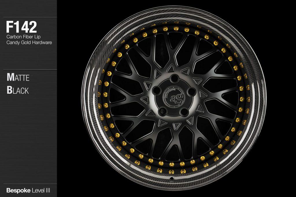 avant-garde-ag-wheels-f142-matte-black-face-carbon-fiber-lip-candy-gold-hardware-1-min